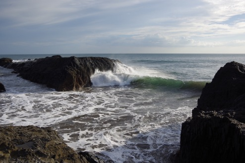 Laavakaljusel rannikul